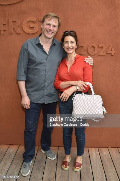 Actors Francois Feroleto and Valerie Karsenti attends the 2017 French Tennis Open Day Six at Roland Garros on June 2 2017 in Paris France