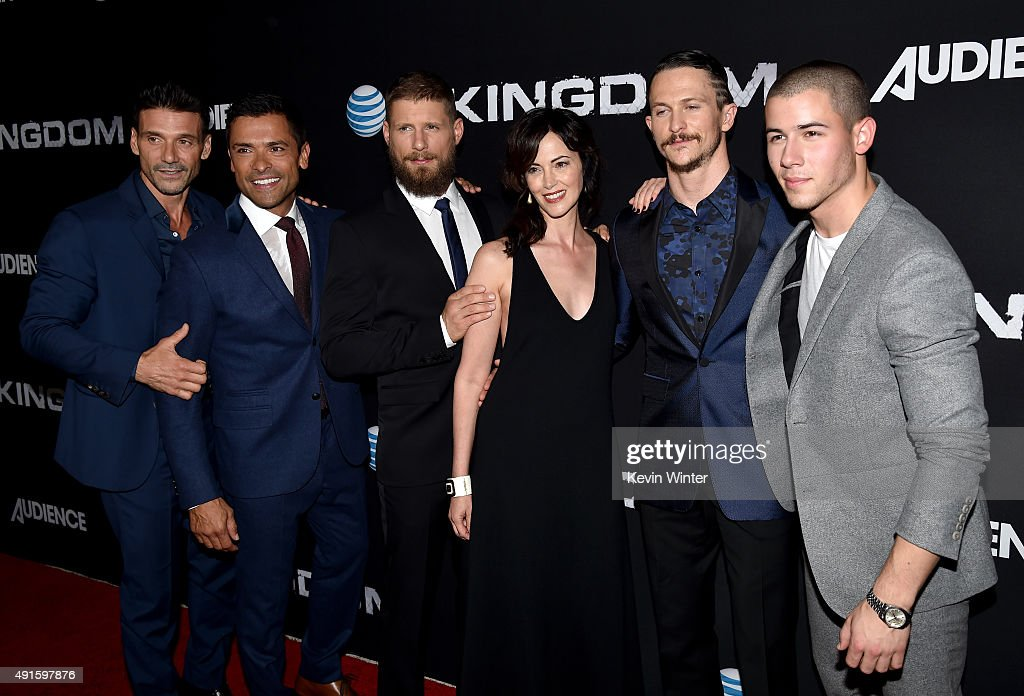 Actors Frank Grillo Mark Consuelos Matt Lauria Joanna Going Jonathan Tucker and Nick Jonas attend the premiere of DIRECTV's 'Kingdom' Season 2 at...