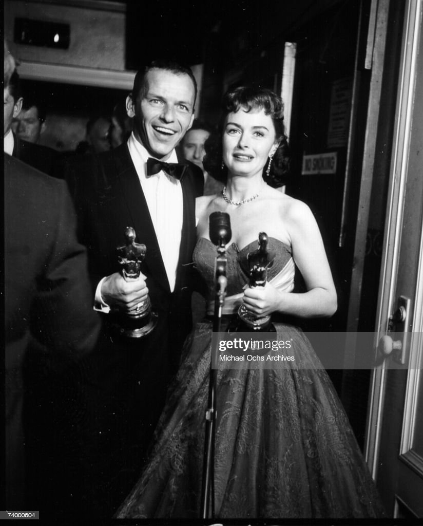 Actors Frank Sinatra and Donna Reed pose for a portrait after winning best supporting actor and best supporting actress Oscars on for their roles in the film 'From Here To Eternity' at the Academy Awards ceremony on March 25, 1954 in Hollywood, California.