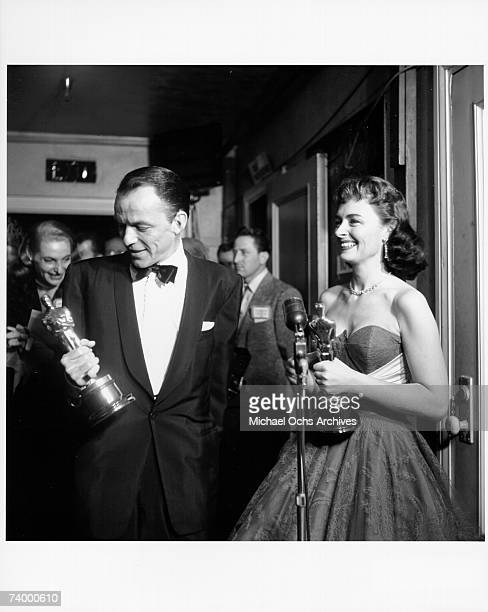 Actors Frank Sinatra and Donna Reed pose for a portrait after winning best supporting actor and best supporting actress Oscars on for their roles in...