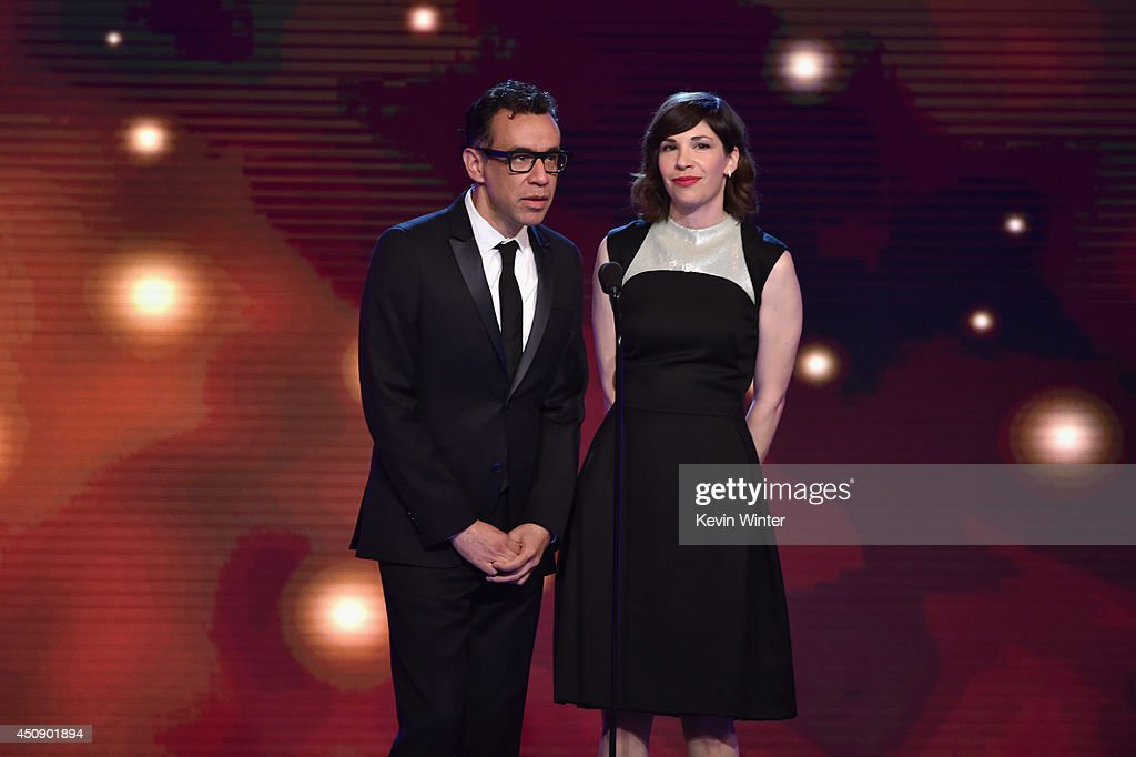 Actors <a gi-track='captionPersonalityLinkClicked' href=/galleries/search?phrase=Fred+Armisen&family=editorial&specificpeople=221426 ng-click='$event.stopPropagation()'>Fred Armisen</a> and <a gi-track='captionPersonalityLinkClicked' href=/galleries/search?phrase=Carrie+Brownstein&family=editorial&specificpeople=870017 ng-click='$event.stopPropagation()'>Carrie Brownstein</a> speak onstage during the 4th Annual Critics' Choice Television Awards at The Beverly Hilton Hotel on June 19, 2014 in Beverly Hills, California.