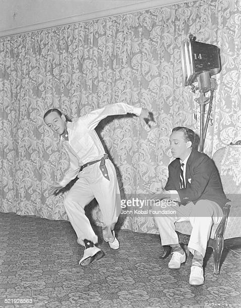 Actors Fred Astaire and Bing Crosby for Paramount Pictures rehearsing choreography for the movie 'Blue Skies' 1946