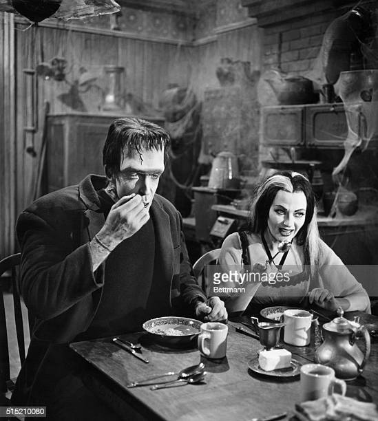 Actors Fred Gwynne and Yvonne DeCarlo share an undoubtedly ghoulish breaksfast in their roles as Herman and Lily Munster on The Munsters television...