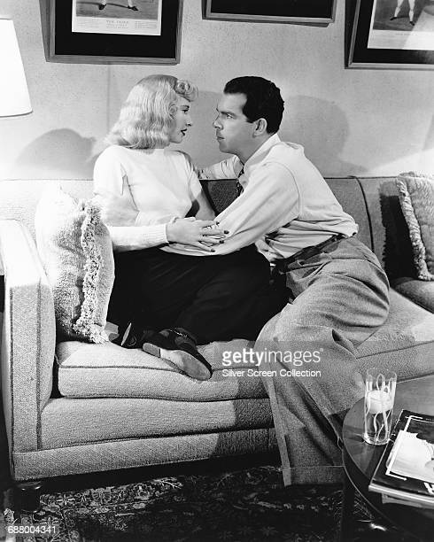 Actors Fred MacMurray as Walter Neff and Barbara Stanwyck as Phyllis Dietrichson in the film 'Double Indemnity' directed by Billy Wilder 1944