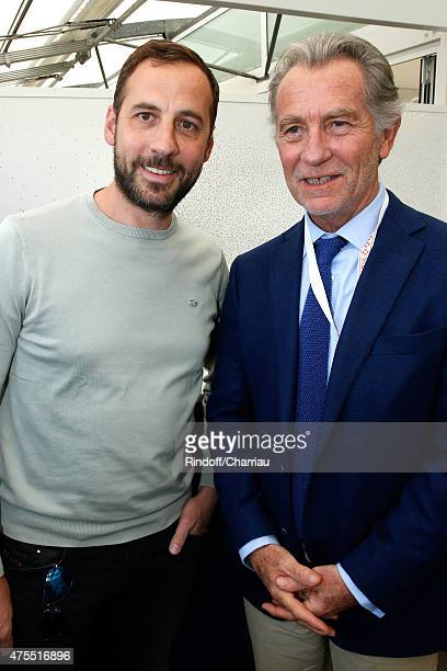 Actors Fred Testot and William Leymergie attend the 2015 Roland Garros French Tennis Open Day Nine on June 1 2015 in Paris France