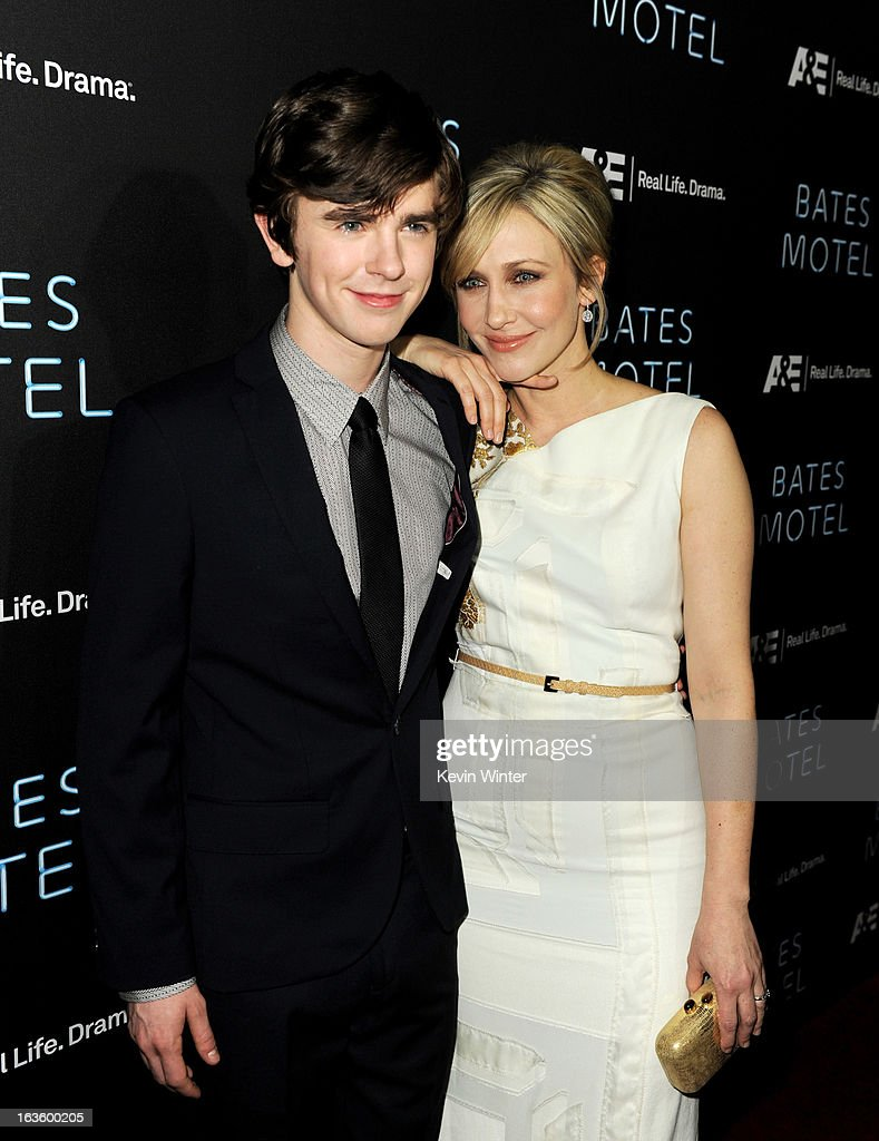 Actors Freddie Highmore (L) and Vera Farmiga arrive at the premiere of A&E Network's 'Bates Motel' at Soho House on March 12, 2013 in West Hollywood, California.