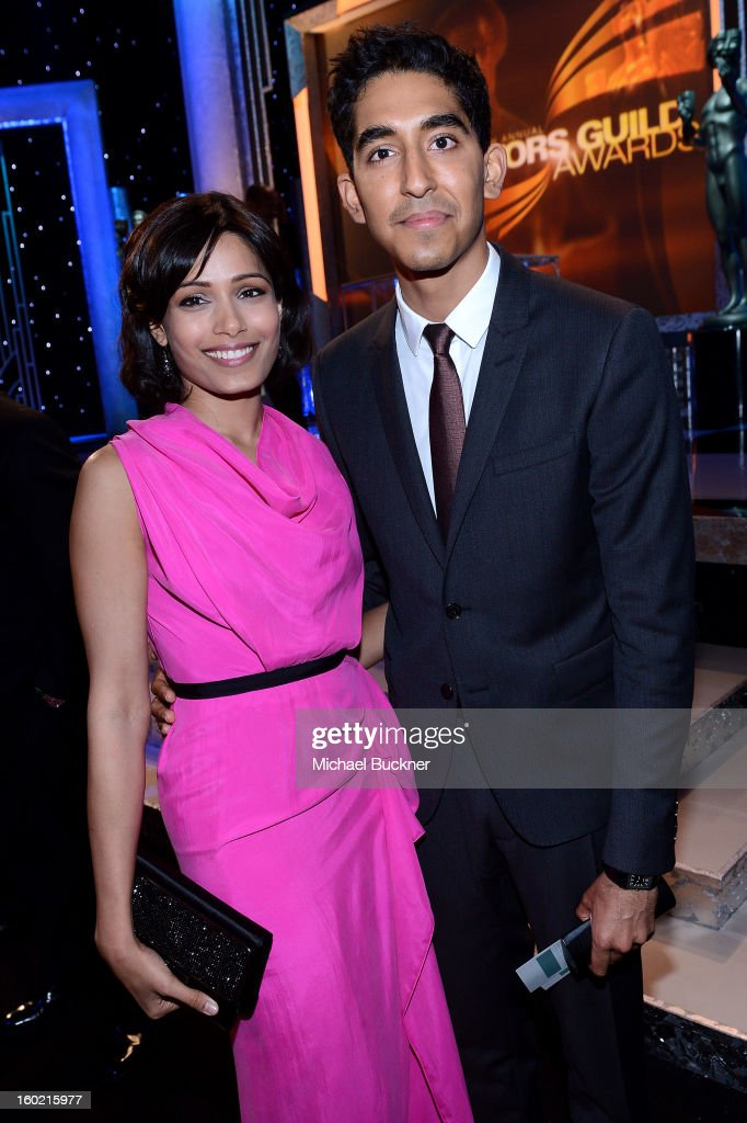Actors <a gi-track='captionPersonalityLinkClicked' href=/galleries/search?phrase=Freida+Pinto&family=editorial&specificpeople=5518973 ng-click='$event.stopPropagation()'>Freida Pinto</a> and <a gi-track='captionPersonalityLinkClicked' href=/galleries/search?phrase=Dev+Patel&family=editorial&specificpeople=5123545 ng-click='$event.stopPropagation()'>Dev Patel</a> attend the 19th Annual Screen Actors Guild Awards at The Shrine Auditorium on January 27, 2013 in Los Angeles, California. (Photo by Michael Buckner/WireImage) 23116_019_0139.jpg
