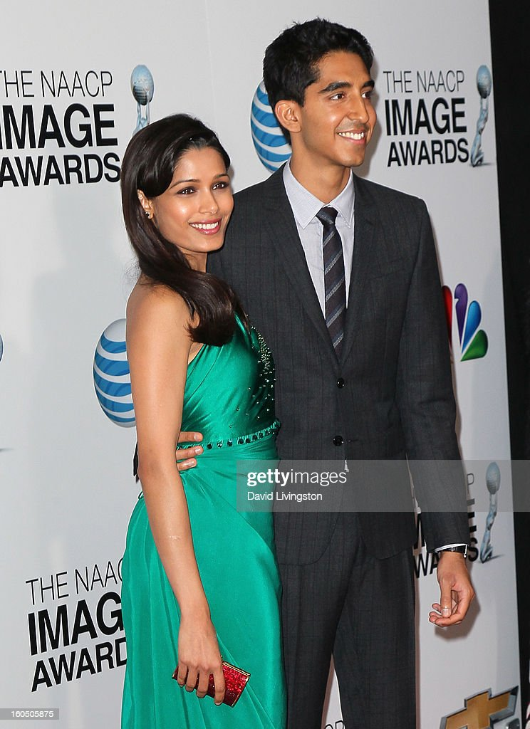 Actors Freida Pinto (L) and Dev Patel attend the 44th NAACP Image Awards at the Shrine Auditorium on February 1, 2013 in Los Angeles, California.