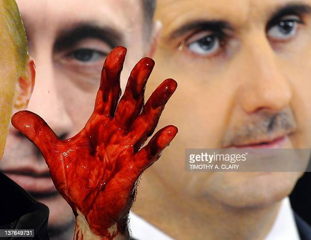 Actors from Avaaz wearing giant masks of Bashar alAssad and Vladimir Putin dump dozens of bloodied body bags outside the UN Security Council building...