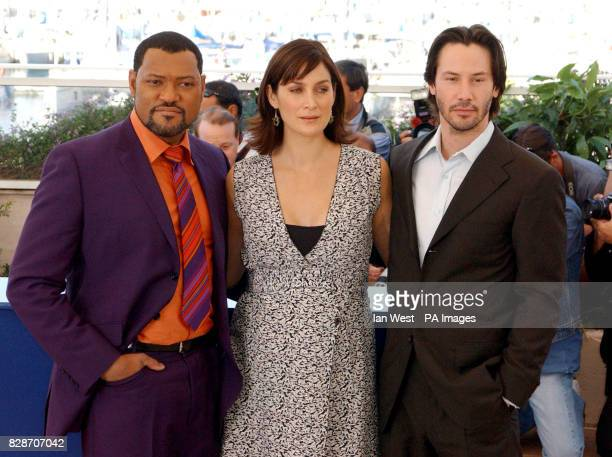 Actors from left to right Laurence Fishburne CarrieAnne Mossand Keanu Reeves pose for photographers during a photocall to promote their new film The...