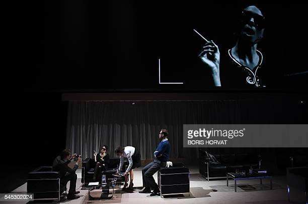 Actors from the collective 'Si vous pouviez lecher mon coeur' perform during the rehearsal of '2666' directed by Julien Gosselin on July 6 2016...