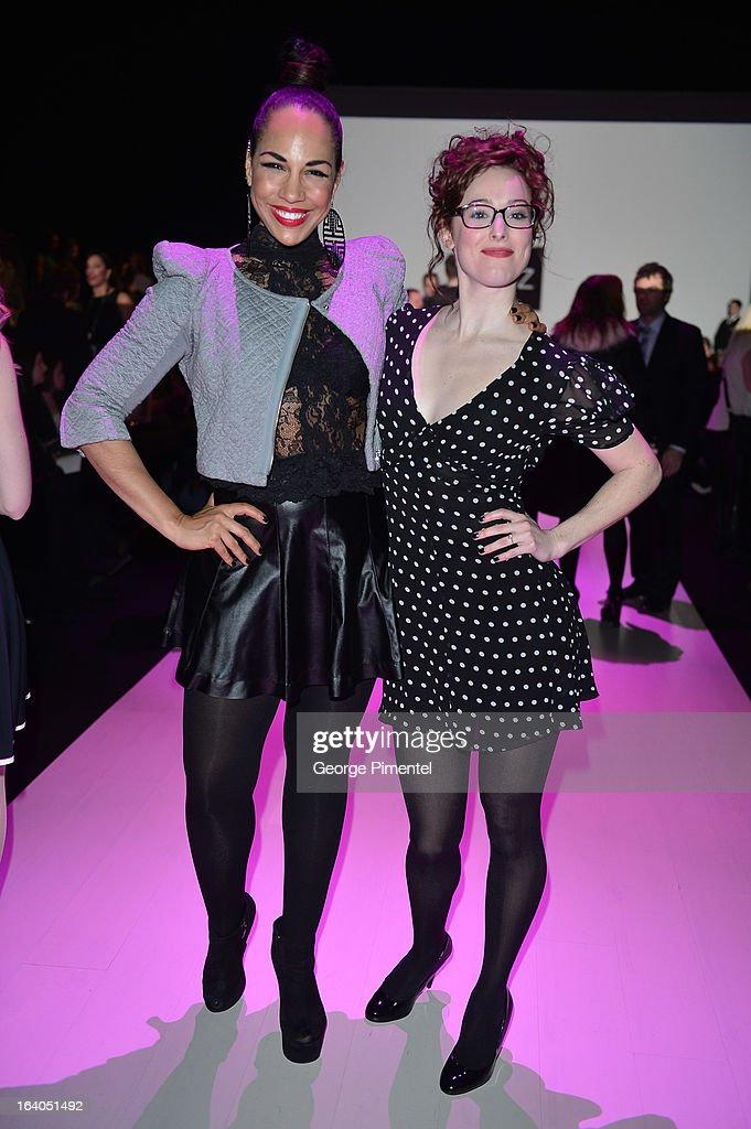 Actors from the tv series 'Seed' Amanda Brugel and Carrie-Lynn Neales attend World MasterCard Fashion Week Fall 2013 Collection at David Pecaut Square on March 18, 2013 in Toronto, Canada.