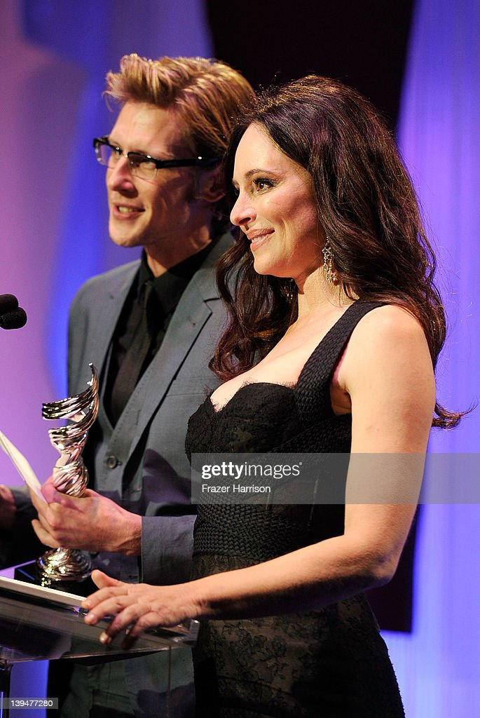 Actors Gabriel Mann and Madeleine Stowe speak onstage during the 14th Annual Costume Designers Guild Awards With Presenting Sponsor Lacoste held at The Beverly Hilton hotel on February 21, 2012 in Beverly Hills, California.
