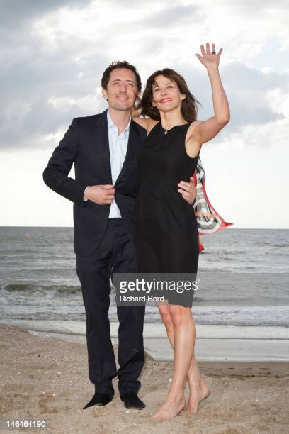 Actors Gad Elmaleh and Sophie Marceau pose as they attend the 26th Cabourg Romantic Film Festival on June 16 2012 in Cabourg France