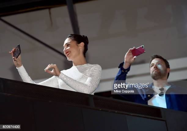 Actors Gal Gadot and Ben Affleck take photos during the 'Justice League' autograph signing at ComicCon International 2017 at San Diego Convention...