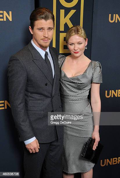 Actors Garrett Hedlund and Kirsten Dunst arrive at the Los Angeles premiere of 'Unbroken' at The Dolby Theatre on December 15 2014 in Hollywood...