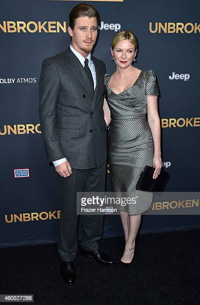 Actors Garrett Hedlund and Kirsten Dunst arrive at the Premiere Of Universal Studios' 'Unbroken' at TCL Chinese Theatre on December 15 2014 in...