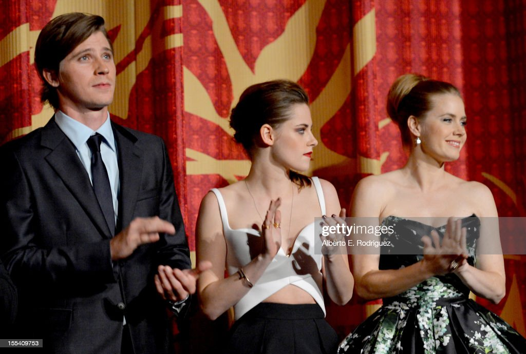 Actors <a gi-track='captionPersonalityLinkClicked' href=/galleries/search?phrase=Garrett+Hedlund&family=editorial&specificpeople=2290407 ng-click='$event.stopPropagation()'>Garrett Hedlund</a>, <a gi-track='captionPersonalityLinkClicked' href=/galleries/search?phrase=Kristen+Stewart&family=editorial&specificpeople=2166264 ng-click='$event.stopPropagation()'>Kristen Stewart</a> (L) and <a gi-track='captionPersonalityLinkClicked' href=/galleries/search?phrase=Amy+Adams&family=editorial&specificpeople=213938 ng-click='$event.stopPropagation()'>Amy Adams</a> arrive at the 'On The Road' premiere during the 2012 AFI Fest presented by Audi at Grauman's Chinese Theatre on November 3, 2012 in Hollywood, California.