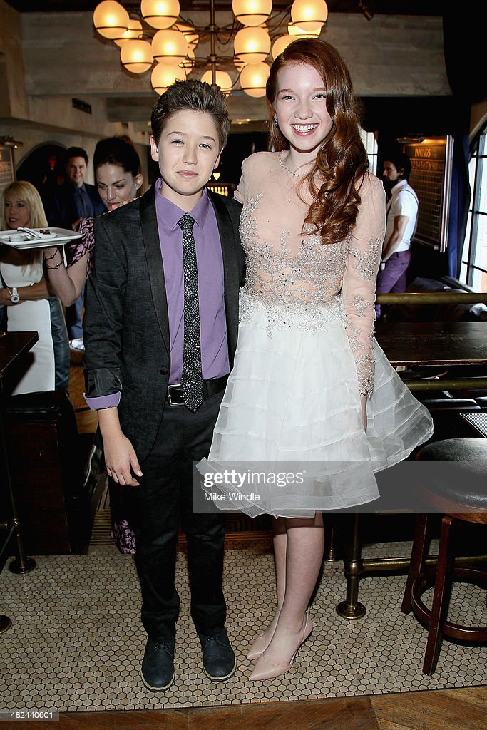 Actors Garrett Ryan (L) and Annalise Basso attend the pre-reception for the screening of Relativity Media's 'Oculus' at The Roosevelt Hotel on April 3, 2014 in Hollywood, California.