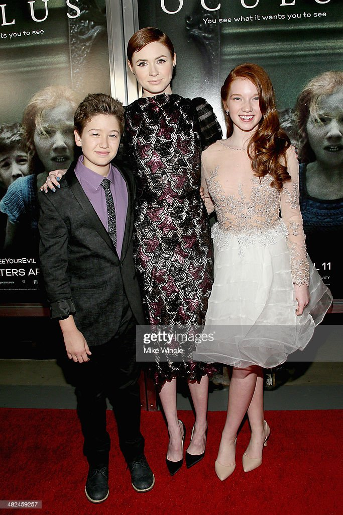 Actors Garrett Ryan, <a gi-track='captionPersonalityLinkClicked' href=/galleries/search?phrase=Karen+Gillan&family=editorial&specificpeople=6876471 ng-click='$event.stopPropagation()'>Karen Gillan</a> and Annalise Basso arrive at the screening of Relativity Media's 'Oculus' at TCL Chinese 6 Theatres on April 3, 2014 in Hollywood, California.