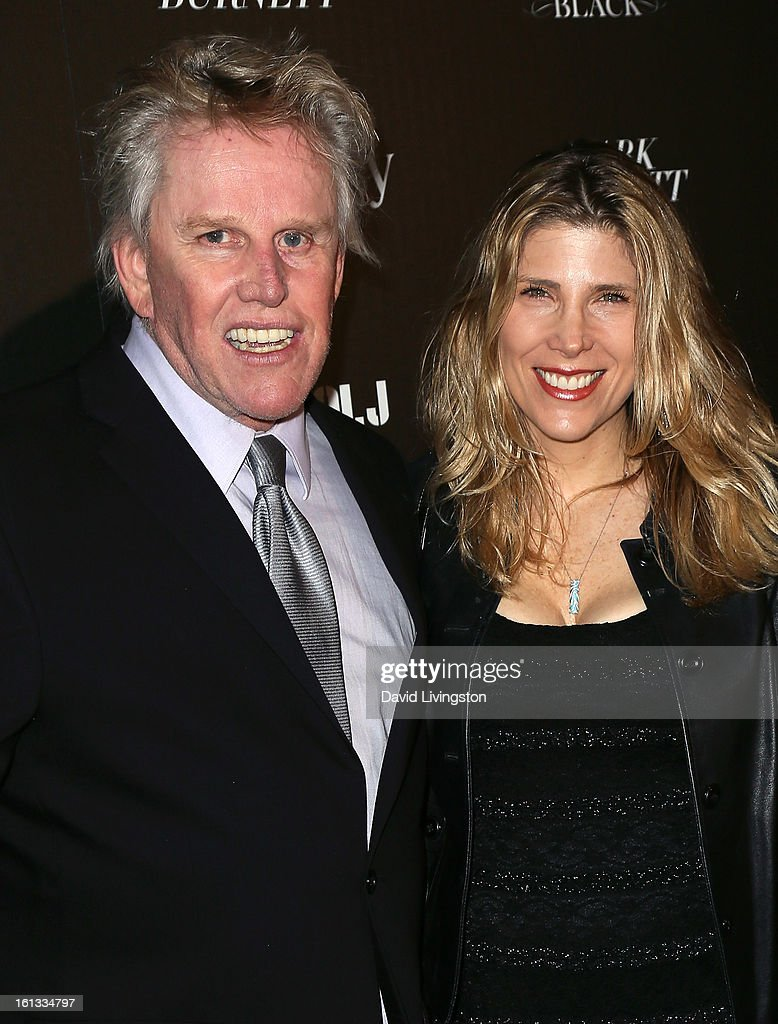 Actors Gary Busey (L) and Steffanie Sampson attend the Hennessy Toasts Achievements In Music event with GRAMMY Host LL Cool J and Mark Burnett at The Bazaar at the SLS Hotel Beverly Hills on February 9, 2013 in Los Angeles, California.