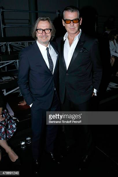 Actors Gary Oldman and Pierce Brosnan attend the Saint Laurent Menswear Spring/Summer 2016 show as part of Paris Fashion Week on June 28 2015 in...