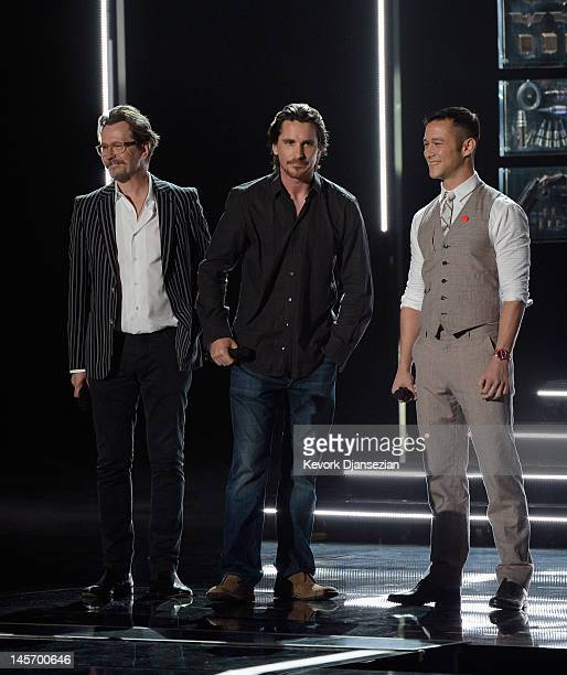 Actors Gary Oldman Christian Bale and Joseph GordonLevitt speak onstage during the 2012 MTV Movie Awards at Gibson Amphitheatre on June 3 2012 in...