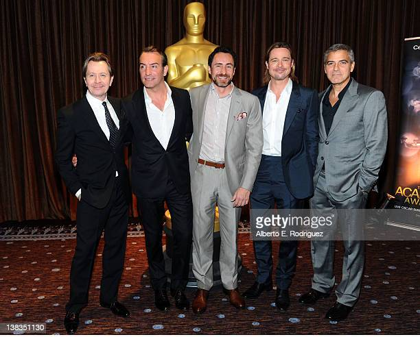 Actors Gary Oldman Jean Dujardin Demian Bichir Brad Pitt and George Clooney attend the 84th Academy Awards Nominations Luncheon at The Beverly Hilton...