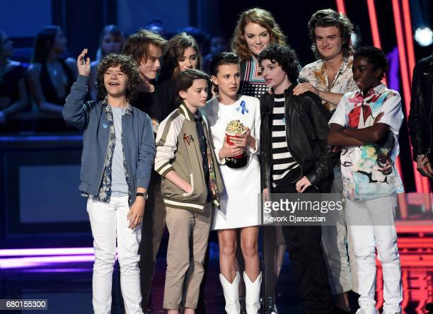 Actors Gaten Matarazzo Charlie Heaton Noah Schnapp Natalia Dyer Shannon Purser Millie Bobby Brown Finn Wolfhard Joe Keery and Caleb McLaughlin accept...