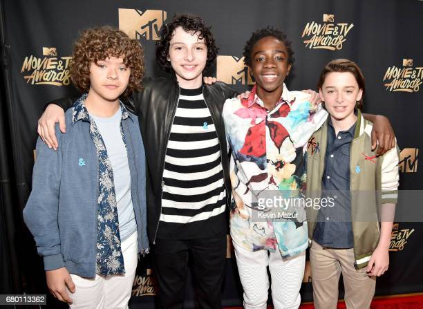 Actors Gaten Matarazzo Finn Wolfhard Caleb McLaughlin and Noah Schnapp attend the 2017 MTV Movie And TV Awards at The Shrine Auditorium on May 7 2017...