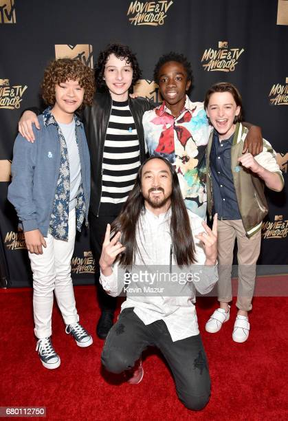 Actors Gaten Matarazzo Finn Wolfhard Caleb McLaughlin Noah Schnapp and DJ Steve Aoki attend the 2017 MTV Movie And TV Awards at The Shrine Auditorium...