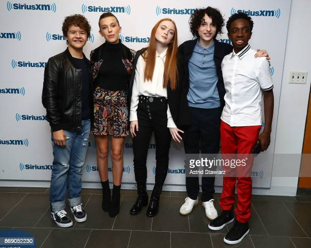 Actors Gaten Matarazzo Millie Bobby Brown Sadie Sink Finn Wolfhard and Caleb McLaughlin attend SiriusXM's 'Town Hall' cast of Stranger Things on...