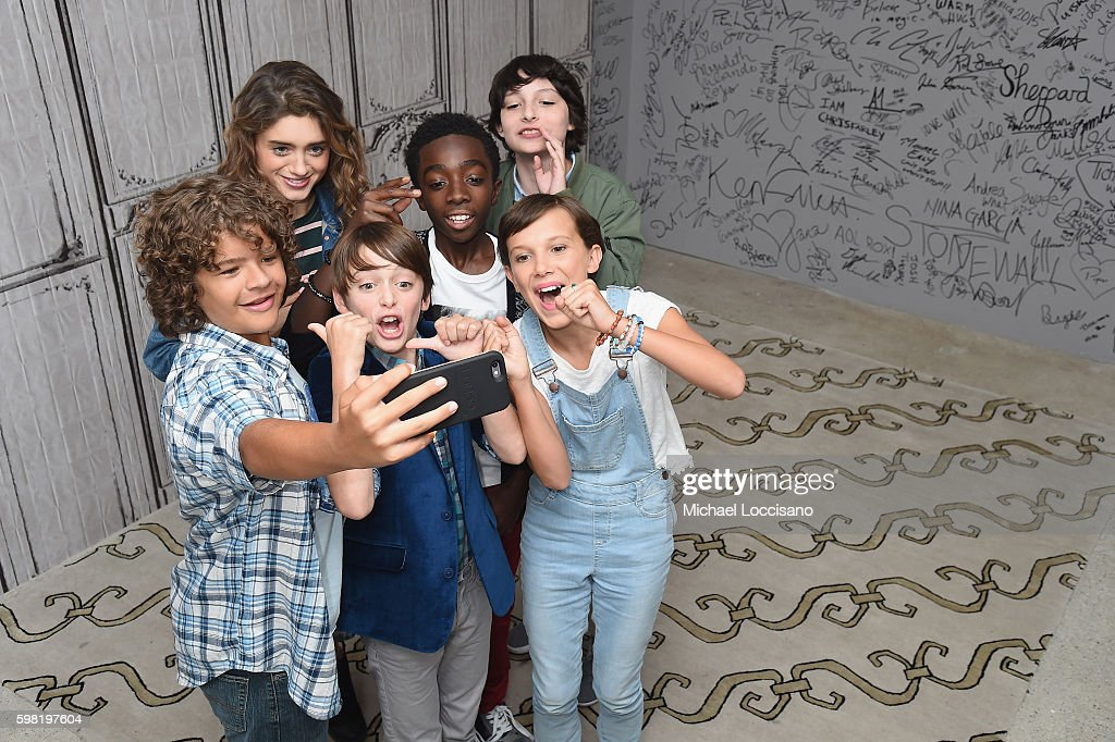 Actors Gaten Matarazzo, Natalia Dyer, Noah Schnapp, Caleb McLaughlin, Finn Wolfhard and Millie Bobby Brown (front right) of 'Stranger Things' attend the BUILD Series at AOL HQ on August 31, 2016 in New York City.