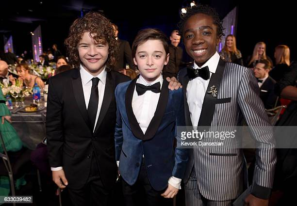 Actors Gaten Matarazzo Noah Schnapp and Caleb McLaughlin attend the 23rd Annual Screen Actors Guild Awards Cocktail Reception at The Shrine Expo Hall...