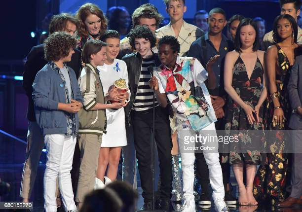 Actors Gaten Matarazzo Noah Schnapp Millie Bobby Brown Finn Wolfhard and Caleb McLaughlin accept the Best Show award onstage during the 2017 MTV...