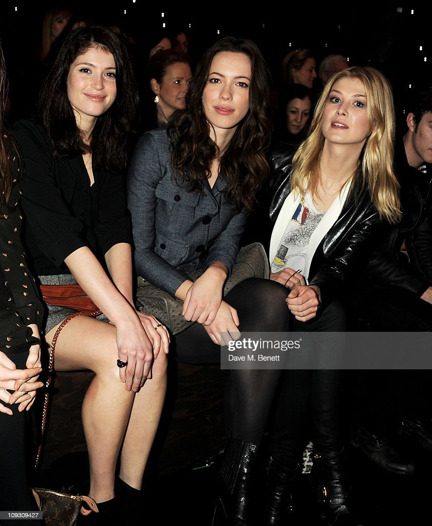 Actors Gemma Arterton, Rebecca Hall and Rosamund Pike sit in the front row at the Mulberry Salon Show at London Fashion Week Autumn/Winter 2011 at Claridge's Hotel on February 20, 2011 in London, England.