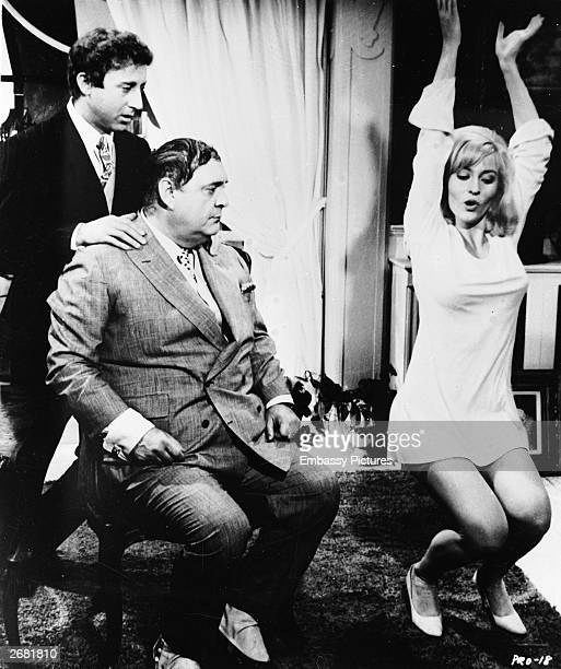 Actors Gene Wilder and Zero Mostel watch as Lee Meredith does a shimmy in a still from the film 'The Producers' directed by Mel Brooks 1968