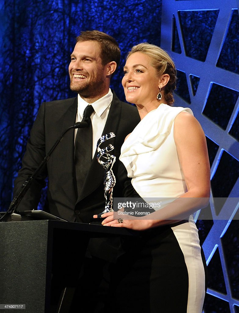 Actors Geoff Stults (L) and Elisabeth Rohm speak onstage at the 16th Costume Designers Guild Awards with presenting sponsor Lacoste at The Beverly Hilton Hotel on February 22, 2014 in Beverly Hills, California.
