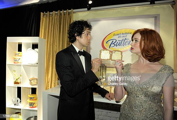 Actors Geoffrey Arend and Christina Hendricks attend the I Can't Believe It's Not Butter Toast Bar in The HP Touchsmart Gift Lounge backstage at the...