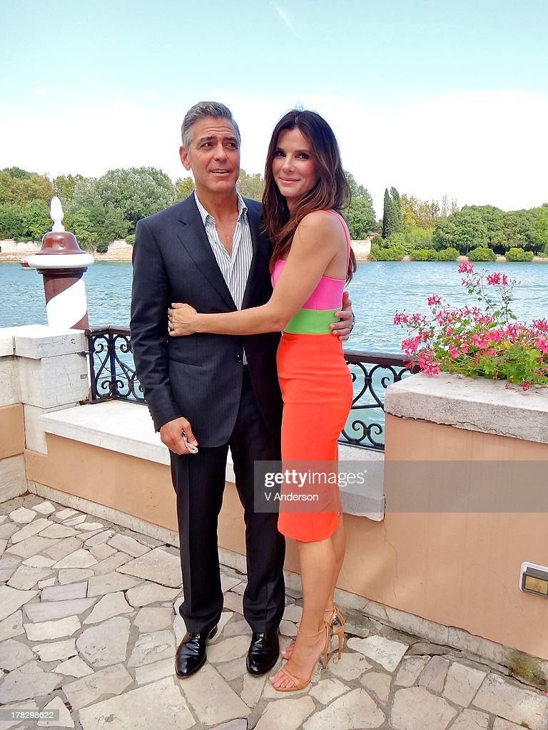 Actors George Clooney and Sandra Bullock attend the 'Gravity' lunch during the 70th Venice International Film Festival at the Hotel Cipriani on...