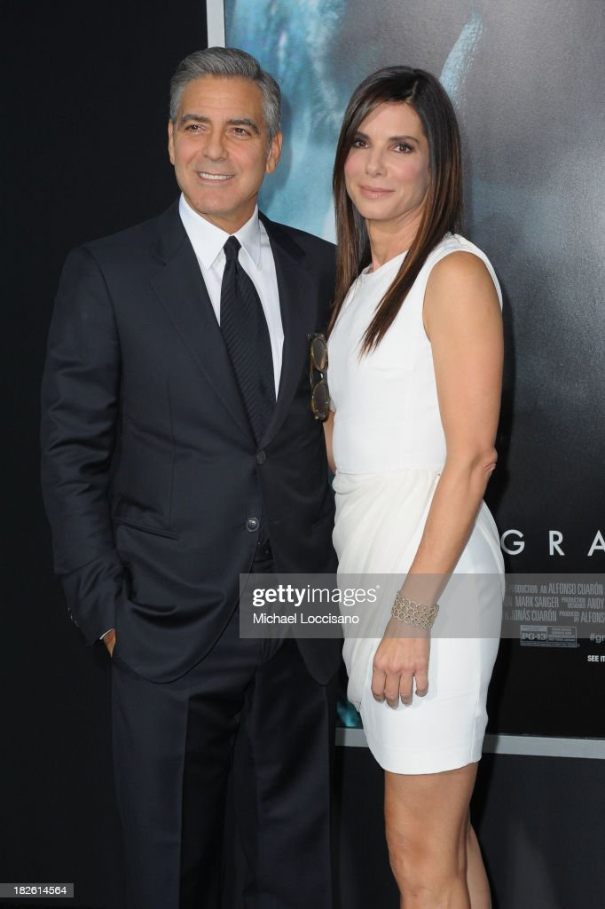 Actors <a gi-track='captionPersonalityLinkClicked' href=/galleries/search?phrase=George+Clooney&family=editorial&specificpeople=202529 ng-click='$event.stopPropagation()'>George Clooney</a> and <a gi-track='captionPersonalityLinkClicked' href=/galleries/search?phrase=Sandra+Bullock&family=editorial&specificpeople=202248 ng-click='$event.stopPropagation()'>Sandra Bullock</a> attend the 'Gravity' premiere at AMC Lincoln Square Theater on October 1, 2013 in New York City.