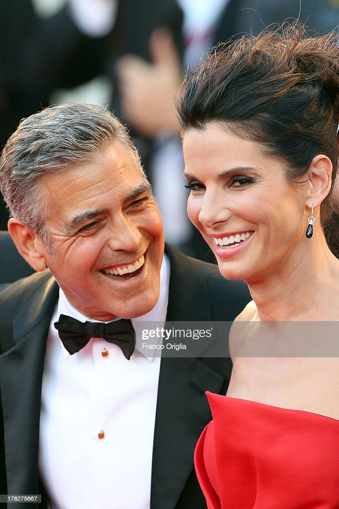Actors <a gi-track='captionPersonalityLinkClicked' href=/galleries/search?phrase=George+Clooney&family=editorial&specificpeople=202529 ng-click='$event.stopPropagation()'>George Clooney</a> and <a gi-track='captionPersonalityLinkClicked' href=/galleries/search?phrase=Sandra+Bullock&family=editorial&specificpeople=202248 ng-click='$event.stopPropagation()'>Sandra Bullock</a> attend the Opening Ceremony And 'Gravity' Premiere at Palazzo del Cinema on August 28, 2013 in Venice, Italy.