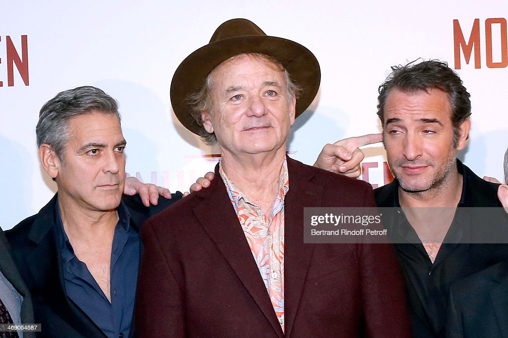 Actors <a gi-track='captionPersonalityLinkClicked' href=/galleries/search?phrase=George+Clooney&family=editorial&specificpeople=202529 ng-click='$event.stopPropagation()'>George Clooney</a>, <a gi-track='captionPersonalityLinkClicked' href=/galleries/search?phrase=Bill+Murray&family=editorial&specificpeople=171116 ng-click='$event.stopPropagation()'>Bill Murray</a> and <a gi-track='captionPersonalityLinkClicked' href=/galleries/search?phrase=Jean+Dujardin&family=editorial&specificpeople=620972 ng-click='$event.stopPropagation()'>Jean Dujardin</a> attend the 'Monuments Men' : Premiere at Cinema UGC Normandie on February 12, 2014 in Paris, France.