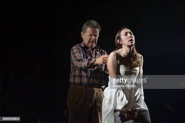 Actors George Costigan and Pauline Knowles perform on stage 'Oresteia This Restless House' during a photo call at Lyceum Theatre as part of the 70th...