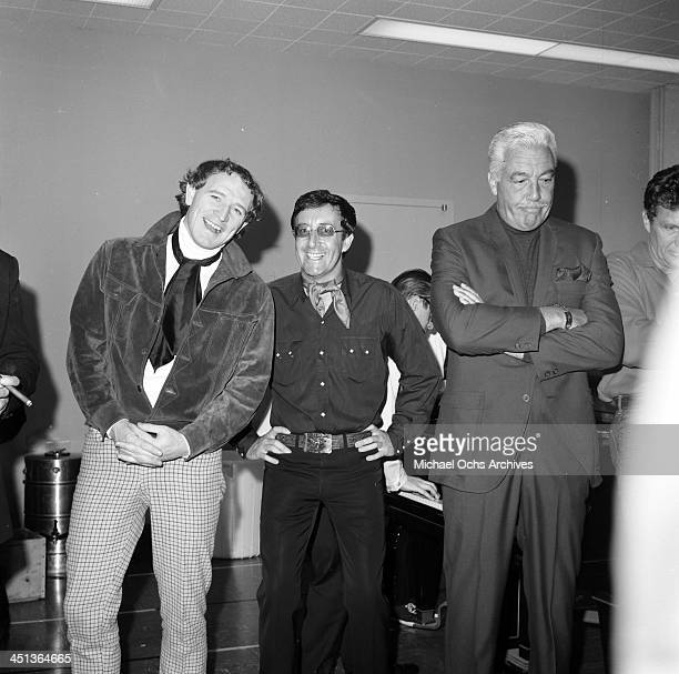 Actors George Harris and Peter Sellers and Cesar Romero attend a party in Los Angeles California
