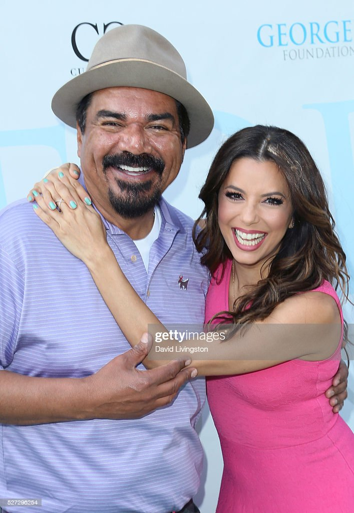 Actors George Lopez (L) and Eva Longoria attend the Ninth Annual George Lopez Celebrity Golf Classic at Lakeside Golf Club on May 2, 2016 in Burbank, California.