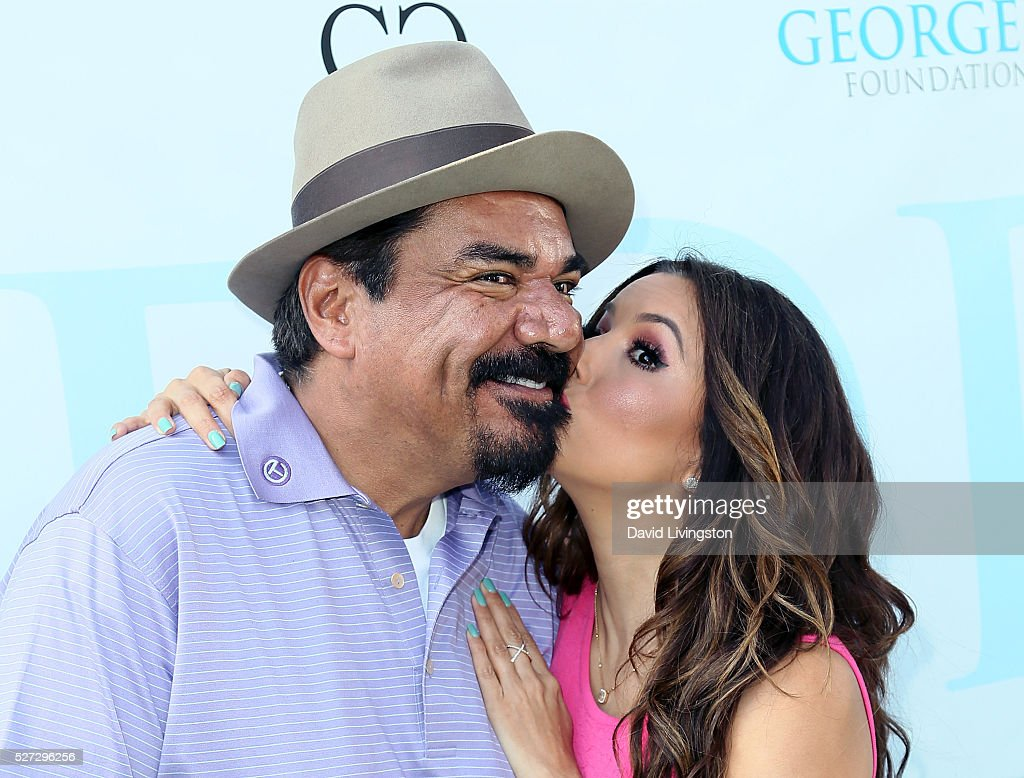 Actors George Lopez (L) and <a gi-track='captionPersonalityLinkClicked' href=/galleries/search?phrase=Eva+Longoria&family=editorial&specificpeople=202082 ng-click='$event.stopPropagation()'>Eva Longoria</a> attend the Ninth Annual George Lopez Celebrity Golf Classic at Lakeside Golf Club on May 2, 2016 in Burbank, California.