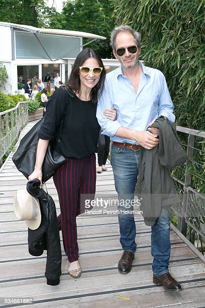 Actors Geraldine Pailhas and Christopher Thompson attend the 2016 French Tennis Open Day Six at Roland Garros on May 27 2016 in Paris France