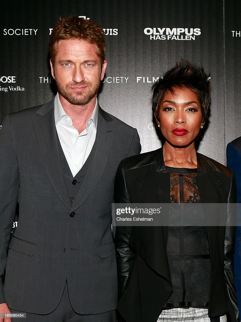 Actors Gerard Butler and Angela Bassett attend The Cinema Society with Roger Dubuis and Grey Goose screening of FilmDistrict's 'Olympus Has Fallen' at the Tribeca Grand Screening Room on March 11, 2013 in New York City.