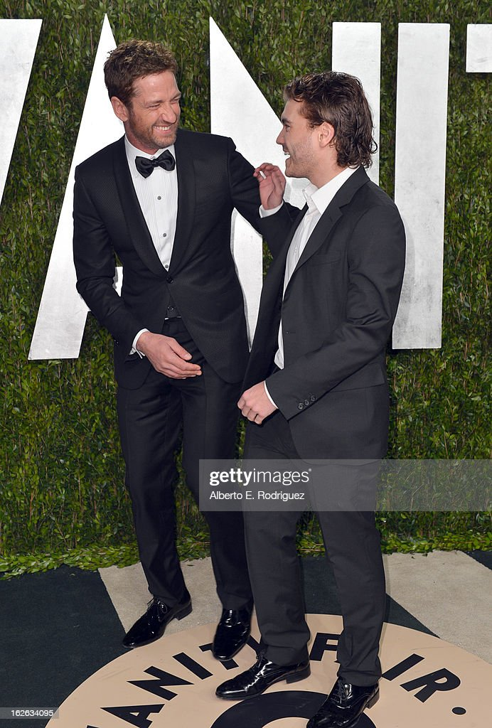 Actors Gerard Butler (L) and Emile Hirsch arrive at the 2013 Vanity Fair Oscar Party hosted by Graydon Carter at Sunset Tower on February 24, 2013 in West Hollywood, California.